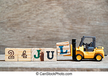 Toy forklift hold block l to complete word 24 jul on wood background (Concept for calendar date in month July)