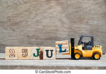Toy forklift hold block l to complete word 25 jul on wood background (Concept for calendar date in month July)