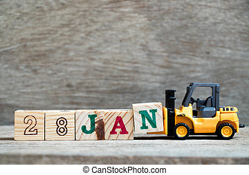 Toy forklift hold block N to complete word 28jan on wood background (Concept for calendar date in 28 month January)