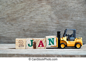 Toy forklift hold block N to complete word 2jan on wood background (Concept for calendar date in 2 month January)