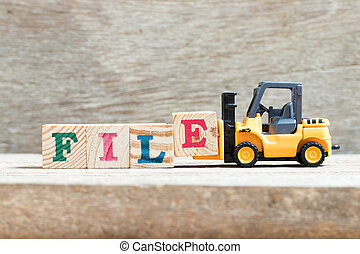 Toy forklift hold letter block e in word file on wood background