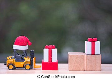 Toy forklift truck with Christmas gift box