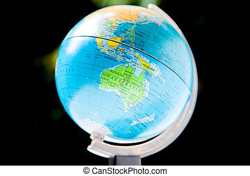 Toy globe isolated over black background with a clipping path