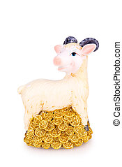 toy goat with golden coins