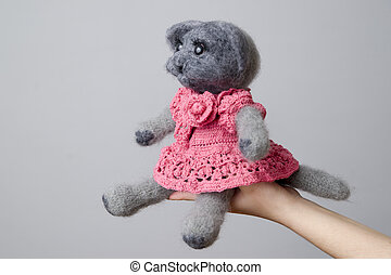 Toy gray cat in a gift