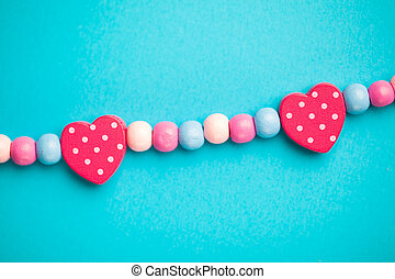 toy heart shapes on blue background