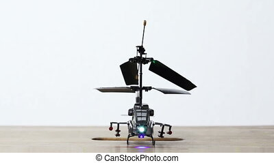 toy helicopter is on table, supporting slides fail in hole,...