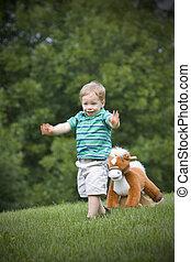 Toy horse chasing boy