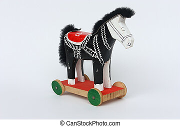 Toy horse on the wheels