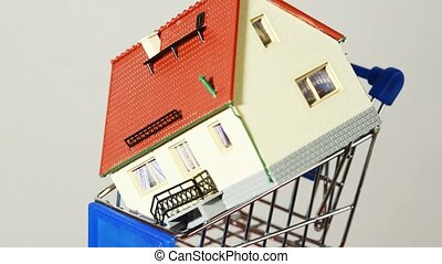 Toy house placed on top of little trolley turning around and...