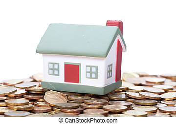 toy house to stand on a heap of coins