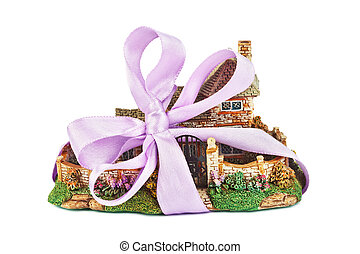 Toy house with bow as gift