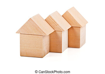 Toy houses made of wooden blocks