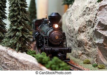Toy Locomotive on train track - Black model Locomotive on...