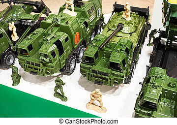 Toy military vehicles, weapons, and soldiers
