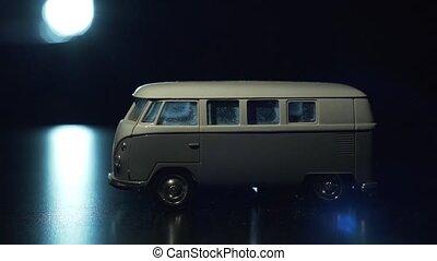 Toy minivan in the light of a lantern