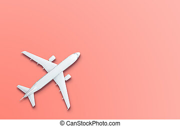 Toy model airplane design miniature on bight living coral background. The idea of tickets for the trip, traveling by plane, new discoveries, summer holidays