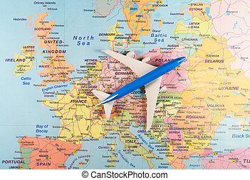 Toy of a plane on the Europe map.