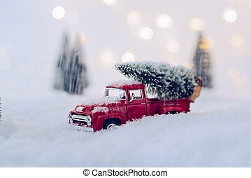 Toy pickup car carrying Christmas tree