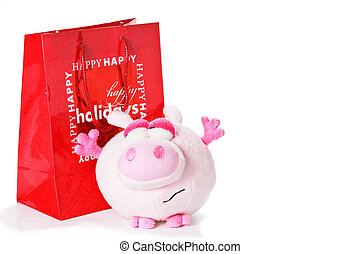 Toy piglet as christmas gift isolated on white
