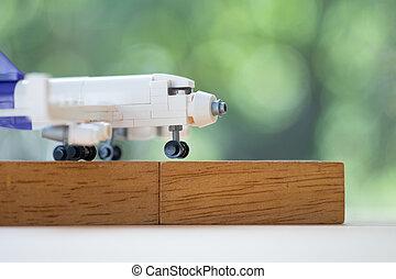 Toy plane model put on wooden blocks