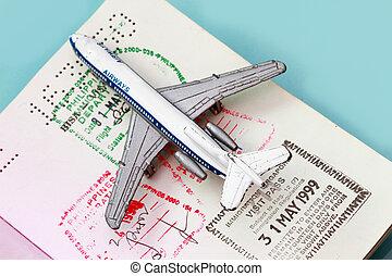 Toy plane on passport