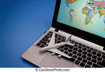 Toy plane on the notebook with world map.