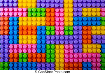 toy plastic building blocks background. top view