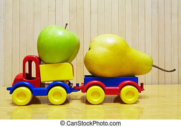 Toy plastic car with apple and pear
