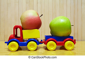 Toy plastic car with apple