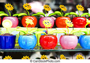 Toy plastic flowers. - Toy plastic flowers on the shelf in ...
