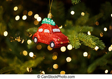 Toy red car on the Christmas tree