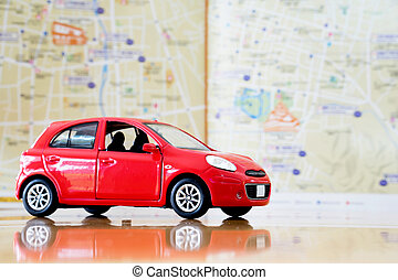 Toy red car on vacation