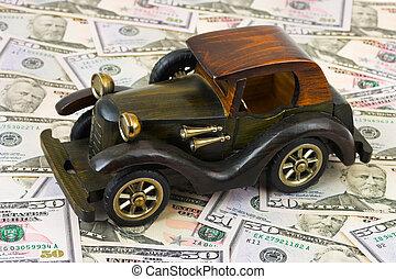 Toy retro car on money background