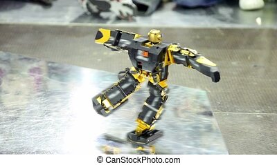Toy robot dance on metal surface