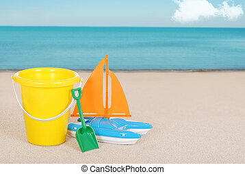 Toy Sailboat and childs bucket
