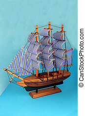 toy sailing boat on
