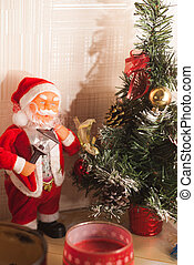 Toy Santa Claus and Christmas tree,