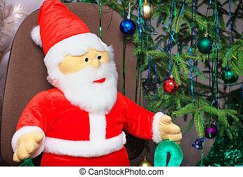 Toy santa claus near a Christmas tree