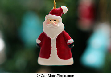 toy Santa Claus on the Christmas tree background closeup