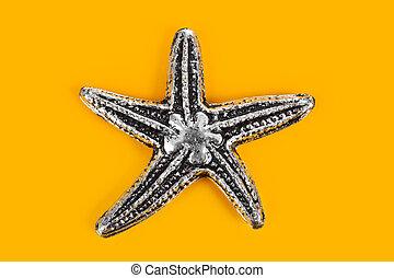 Toy sea star - beach concept background