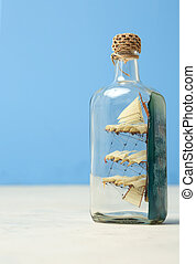 toy ship in a glass botttle - toy boat in a glass botttle
