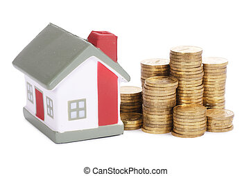 Toy small house and coins in form of diagram