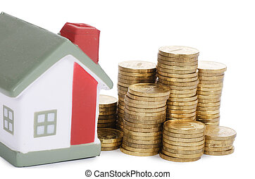 Toy small house and coins in the form of the diagram. concept