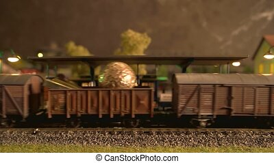 Toy steam locomotive carrying a cars. Transportation and ...