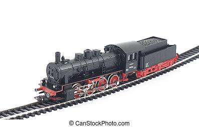 Toy steam locomotive on white background