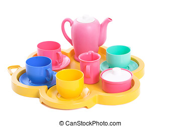 Toy tea china for kids to play with on white background