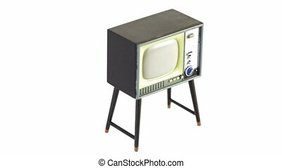 Toy television receiver circling isolated at white...