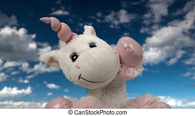 Toy unicorn waving against clouds - Video of cute unicorn ...