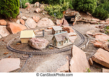 Toy Village and Model Railroad - A model railroad track and...